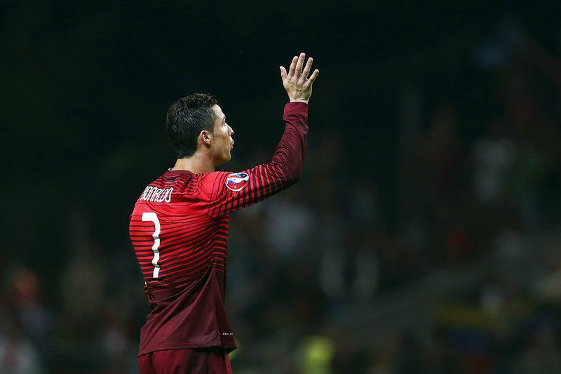 Portugal vs Denmark • epa04969723 Portugal's Cristiano Ronaldo celebrates after the UEFA EURO 2016 qualifying group I soccer match between Portugal and Denmark in Braga, northern Portugal, 08 October 2015. Portugal won 1-0.  EPA/JOSE COELHO