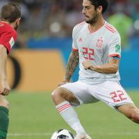 epa06811049 Spain's Isco (R) in action during the FIFA World Cup 2018 group B preliminary round soccer match between Portugal and Spain in Sochi, Russia, 15 June 2018.  (RESTRICTIONS APPLY: Editorial Use Only, not used in association with any commercial entity - Images must not be used in any form of alert service or push service of any kind including via mobile alert services, downloads to mobile devices or MMS messaging - Images must appear as still images and must not emulate match action video footage - No alteration is made to, and no text or image is superimposed over, any published image which: (a) intentionally obscures or removes a sponsor identification image; or (b) adds or overlays the commercial identification of any third party which is not officially associated with the FIFA World Cup)  EPA/RONALD WITTEK   EDITORIAL USE ONLY