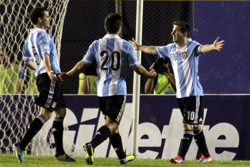 Argentine Lionel Messi (R) celebrates after scoring against Paraguay during their FIFA World Cup Brazil 2014 South American qualifying football match at Defensores del Chaco stadium in Asuncion on September 10, 2013. AFP PHOTO/Gustavo segovia