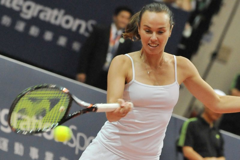 Former tennis star Martina Hingis of Switzerland returns a ball in Taipei on May 26, 2012. Tennis greats Andre Agassi, Steffi Graf, Goran Ivanisevic and Martina Hingis are in Taiwan to attend the 2012 Rise of Legends game, played at the Taipei Arena.   AFP PHOTO / Mandy CHENG