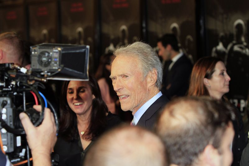 epa06499418 US actor/cast member/director Clint Eastwood (C) arrives for the World Premiere of the 'The 15:17 to Paris' movie at the Warner Bros Studios in Burbank, California, USA, late 05 January 2018 (iussued 06 February 2018). The film will be shown in movie theaters in the US from 09 February 2018 on.  EPA/NINA PROMMER
