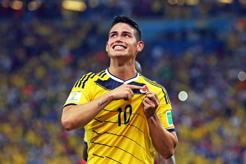 Round of 16 - Colombia vs Uruguay • epaselect epa04288585 Colombia's James Rodriguez celebrates one of his goals during the FIFA World Cup 2014 round of 16 match between Colombia and Uruguay at the Estadio do Maracana in Rio de Janeiro, Brazil, 28 June 2014.   (RESTRICTIONS APPLY: Editorial Use Only, not used in association with any commercial entity - Images must not be used in any form of alert service or push service of any kind including via mobile alert services, downloads to mobile devices or MMS messaging - Images must appear as still images and must not emulate match action video footage - No alteration is made to, and no text or image is superimposed over, any published image which: (a) intentionally obscures or removes a sponsor identification image; or (b) adds or overlays the commercial identification of any third party which is not officially associated with the FIFA World Cup)  EPA/PAOLO AGUILAR   EDITORIAL USE ONLY • epa04288585; Paolo Aguilar