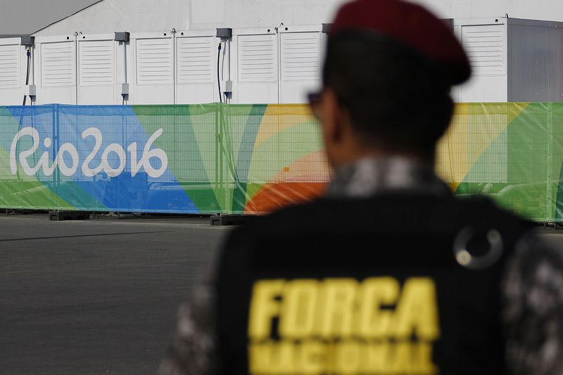 Rio de Janeiro, Jogos Olímpicos • A member of the security forces patrols outside the venues for the upcoming 2016 Rio Olympic Games on July 23, 2016 in Rio de Janeiro, Brazil.   / AFP PHOTO / DAVID GANNON • AFP or licensors