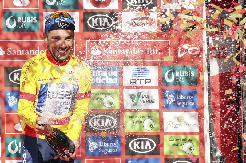 78th Portugal Cycling Tour • epa05451134 Portuguese Rui Vinhas of W52/FC Porto team celebrates on the podium to maintain the yellow jersey on the 5th stage of the 78th Portugal Cycling Tour, disputed between Lamego and Viseu, a distance of 153,2Km,  in Viseu, 01 August 2016.  EPA/NUNO VEIGA • Lusa